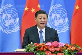 中国の国連代表権獲得から50年を記念する会議で演説する習近平国家主席=25日、北京(新華社=共同)