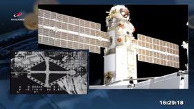 29日、ISSにドッキングするロシアの実験棟「ナウカ」(ロスコスモスの公式ツイッターから・共同)