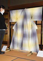 柔らかな光を表現した上田紬の着物。色の濃淡が繊細に表現されている