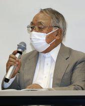 広島市内で開かれた総会で話す、事務局長で原告の高東征二さん=24日午後